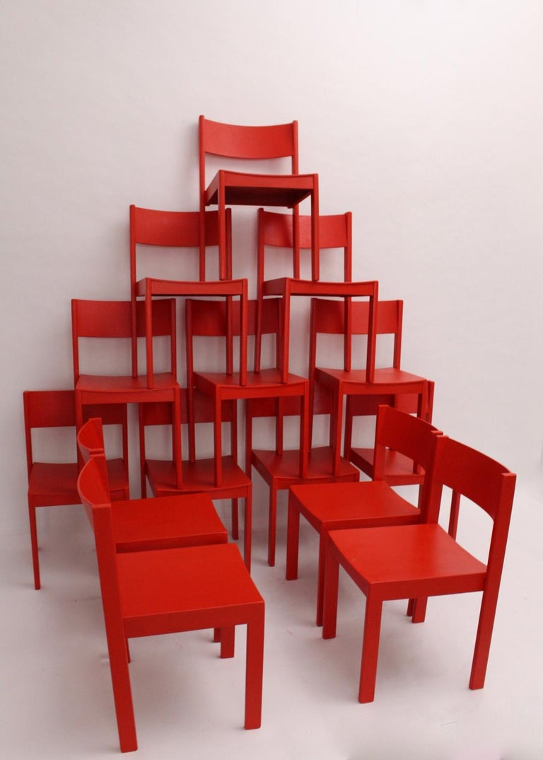 This set of 14 red stackable dining room chairs was made of solid beechwood and plywood - carefully cleaned and newly red lacquered.