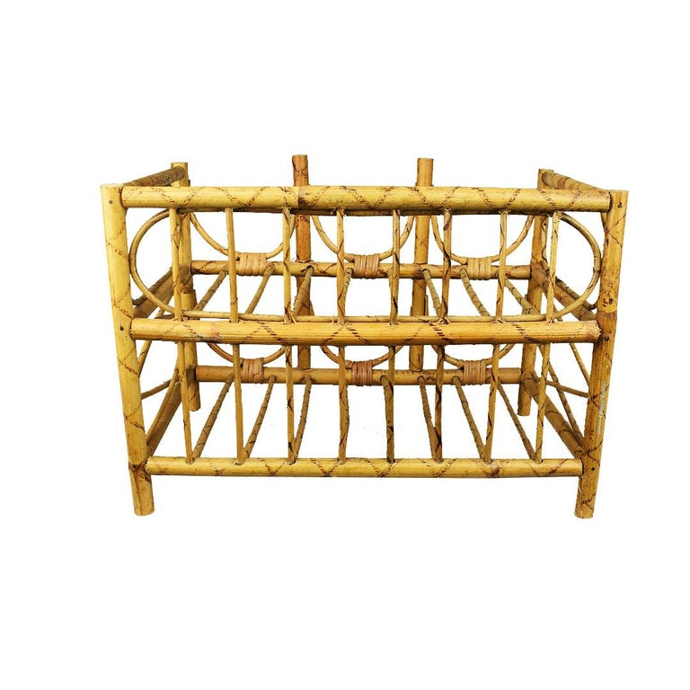 A handmade Mid-Century Modern wine rack created from bentwood bamboo and wicker. Two layers of bamboo are carefully woven together creating a space for 6 bottle so wine (or other beverages in similar shaped bottles) to rest on. The back features