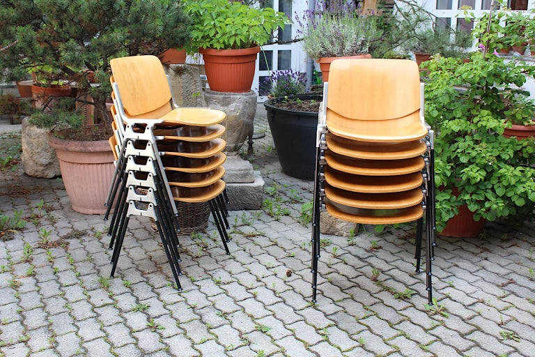 A Mid-Century Modern vintage set of 12 aluminum beech plywood dining chairs DSC 106, which were designed