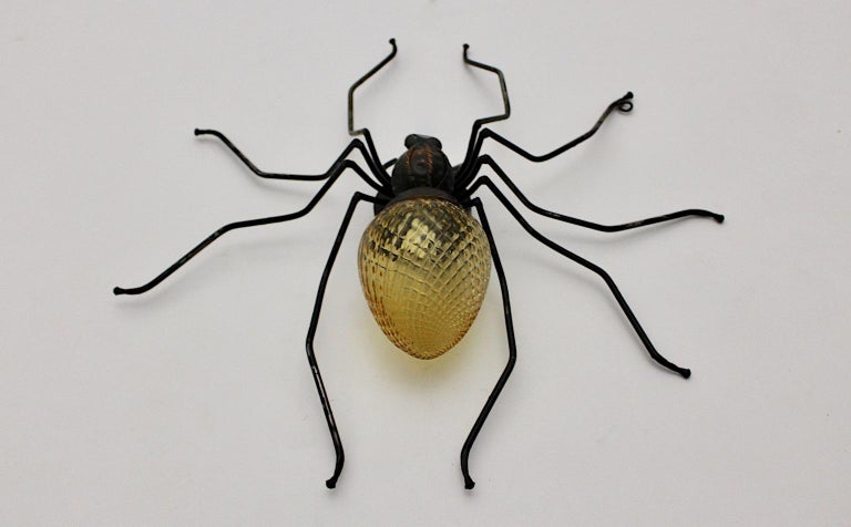 Mid-Century Modern vintage handmade spider fly wall light or sconce or table lamp from yellow grooved glass and metal. The legs were made of partly black lacquered metal wire, while the body from copper and yellow structured glass. This wall light