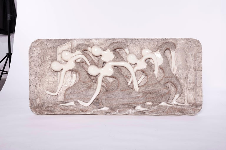 A Mid-Century Modern wall sculpture hand-crafted out of fiberglass. This fabulous sculpture features a unique relief design depicting a free spirit dancer. This piece is eye-catching and a perfect addition to a living room space.