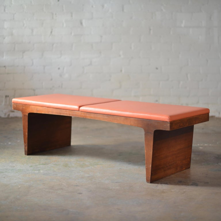 This is a great, unique vintage bench in walnut and orange vinyl upholstery. Very solid construction.