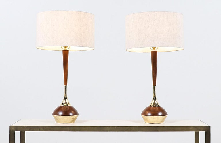 Mid-Century Modern walnut & brass accent table lamps by Laurel   Dimensions 32in H x 8in W x 8in D Lamp shade: 10in H x 17in W.