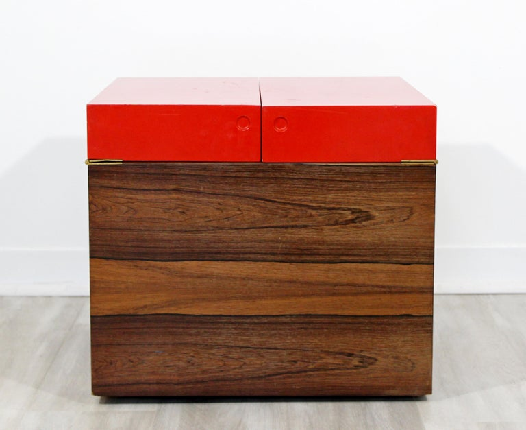 For your consideration is a fantastic, cube mini bar, made of walnut and with a red top, on casters, in the style of Rolf Hesland, circa 1960s. In good vintage condition. The dimensions are 19.75