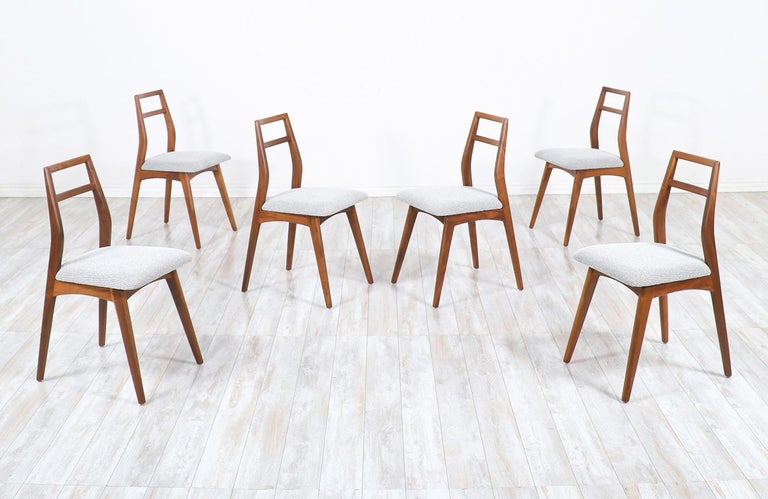 Mid-Century Modern walnut dining chairs.