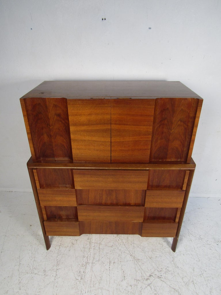 This stunning vintage modern bedroom set by Edmond Spence features the iconic checkerboard front. This set includes two nightstands, a low dresser, and a highboy dresser. An unusual design that offers plenty of room for storage within its many
