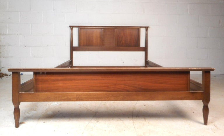 This beautiful vintage modern headboard and footboard comes with metal side rails. A sleek design with beveled edges, a woven style center, and tapered sides. This wonderful bed frame is well made and has an elegant vintage walnut finish throughout.