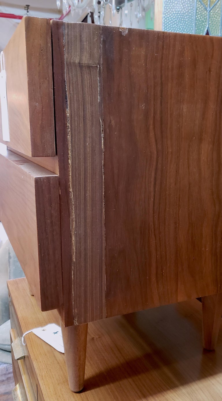 Pair of vintage modern nightstands featuring rich walnut grain, two large drawers, sturdy tapered legs, repair work has been done.  (Please confirm item location - NY or NJ - with dealer).