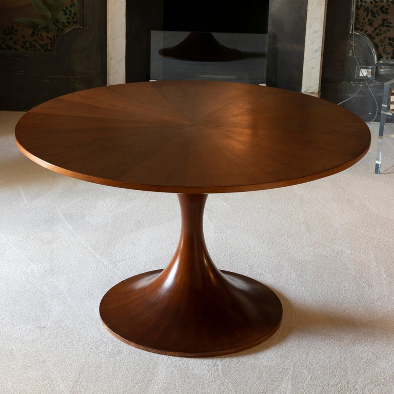 1960s Italian table, round walnut top with inlaid pattern, top it is screwed onto its tulip-shaped base.