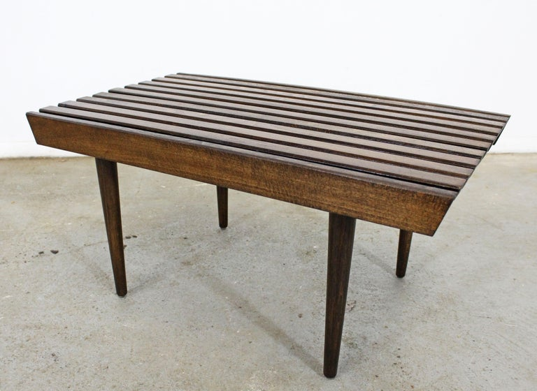 What a find. Offered is a vintage Mid-Century Modern walnut side table. Has been refinished and is in good condition with minor surface wear/chips. It is structurally sound and stabile. It is not signed. Check out our other listings for more