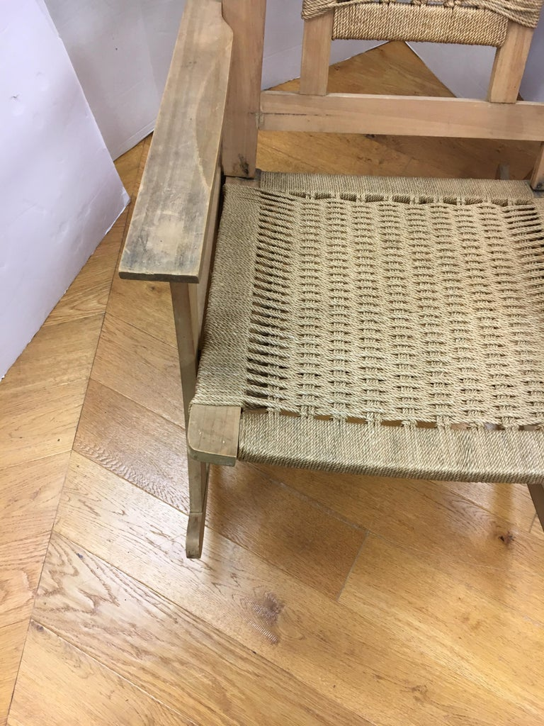 Vintage rocker with woven seats and back make a beautiful Mid-Century Modern addition to your home. Handmade rope seats, great scale, and Danish modern style add to the appeal of the piece.