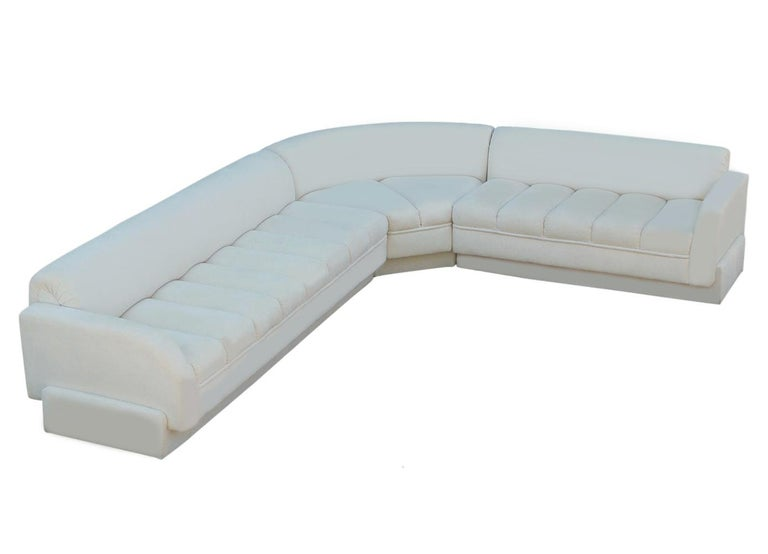 Late 20th Century Mid-Century Modern White Channel Seat Sectional Sofa in White by Directional For Sale