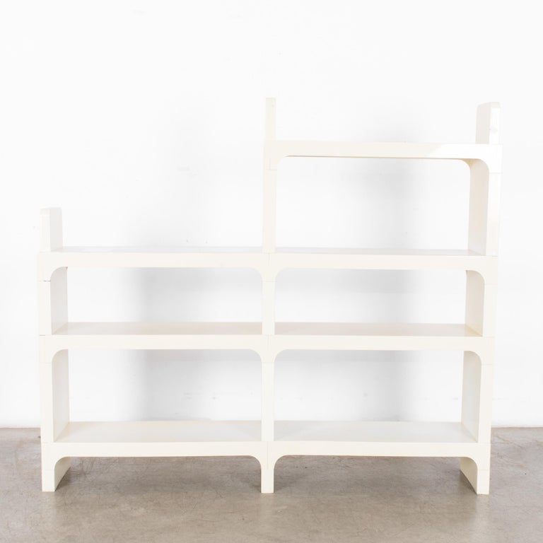 These white modular shelves designed by Austrian artist and designer Olaf von Bohr were produced in France, circa 1970. The sensuous curves that got von Bohr's work acquired for the permanent collection at MoMA are on display here — in profile these