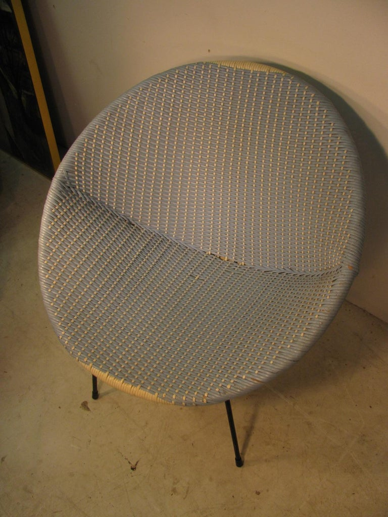 Fabulous and rare two tone woven split reed wicker lounge chair. All original, powder blue with white split reed woven into the chair. Wicker is first painted and then woven across a iron frame using the two separate colors. Chair retains its