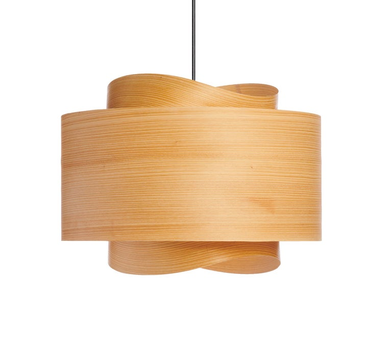 This Mid-Century Modern lighting is an organic modern designer style. This Scandinavian design is a contemporary pendant in wood veneer with a warm light. There are many luxury design applications for this pendant, in dining rooms, entryways or