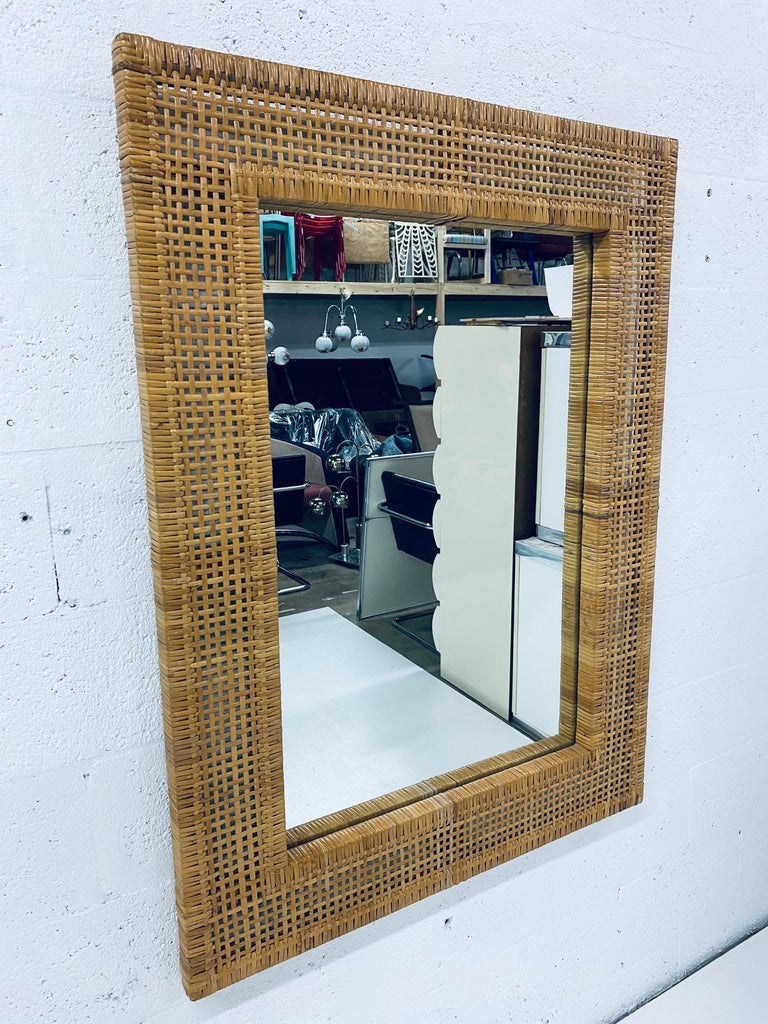 Woven rattan wall mirror, circa 1950s. Can be hung vertical or horizontal.