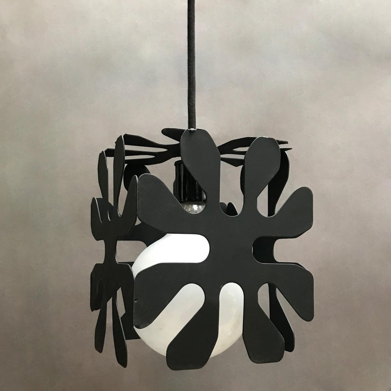 Mid-Century Modern, wrought iron pendant light features a cubed flower motif with 50 inches of cord. Shown with a large opaque bulb but can be used with the bulb of your choice.