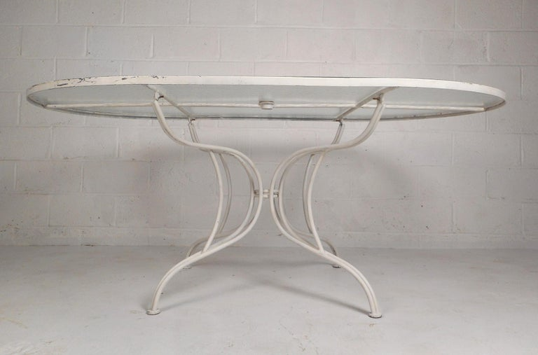 Late 20th Century Mid-Century Modern Wrought Iron Patio Dining Table and Six Chairs For Sale