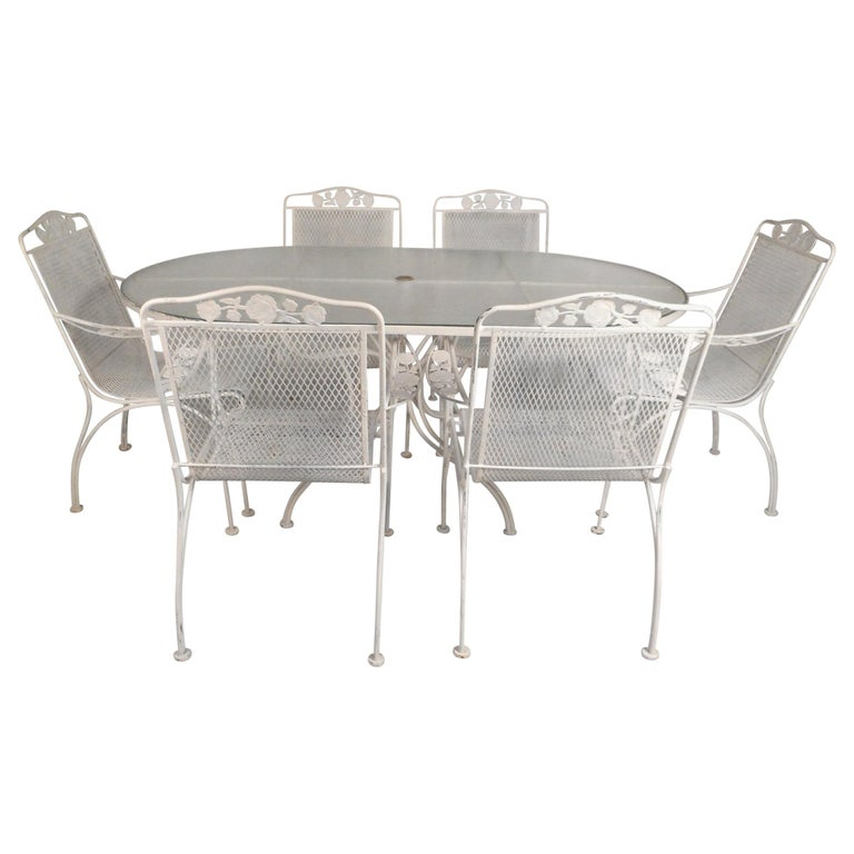 11a3e6980538 Mid-Century Modern Wrought Iron Patio Dining Table and Six Chairs For Sale.  This beautiful vintage modern patio set ...