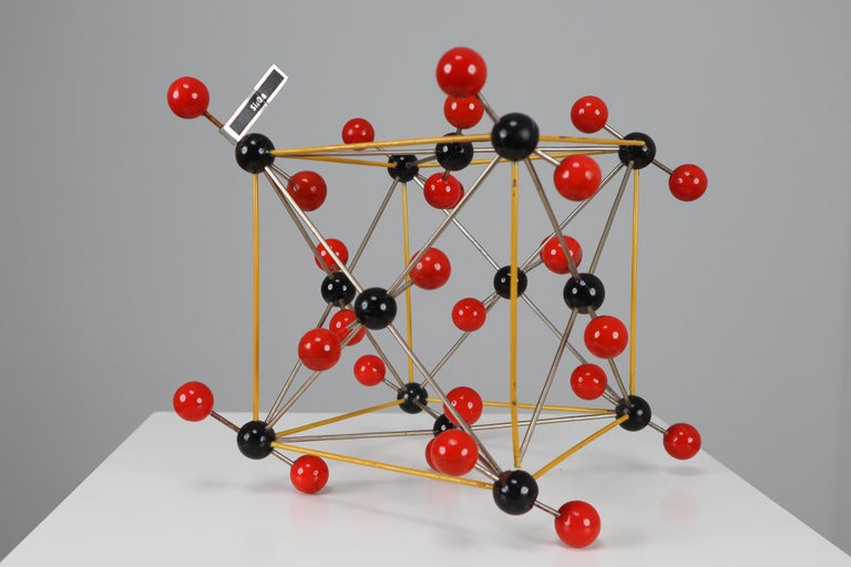 This beautiful patinated metal 1950s molecular structure of