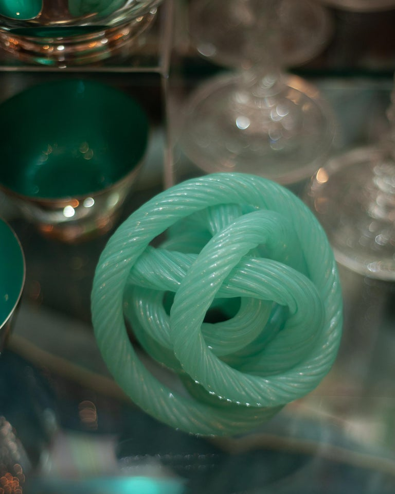 A stunning and decorative sculptural midcentury Murano blue green glass cane rope sculpture.