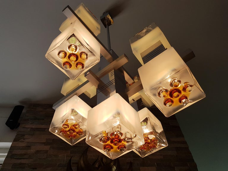 Midcentury chandelier by Mazzega, Italy, 1968. Extraordinary with 9 colored and frosted Murano glass cubes. Perfect vintage condition.