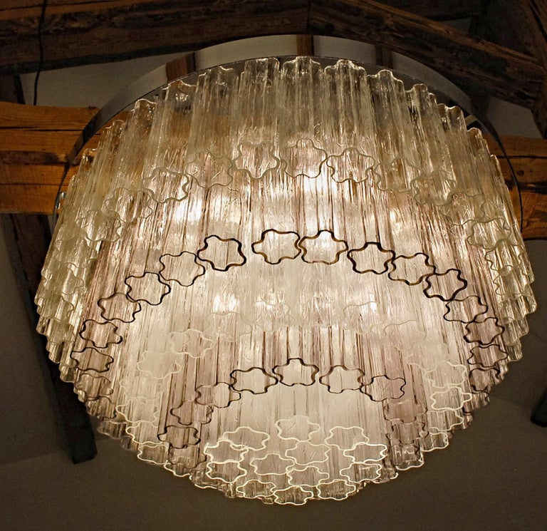 Chandelier has a lovely combination of light amethyst and clear Murano glass.  More than 120 elements. This is a Toni Zuccheri design for Venini.  Amethyst plays a great role on the light output and gives more dept to the fixture. Five tiers, three
