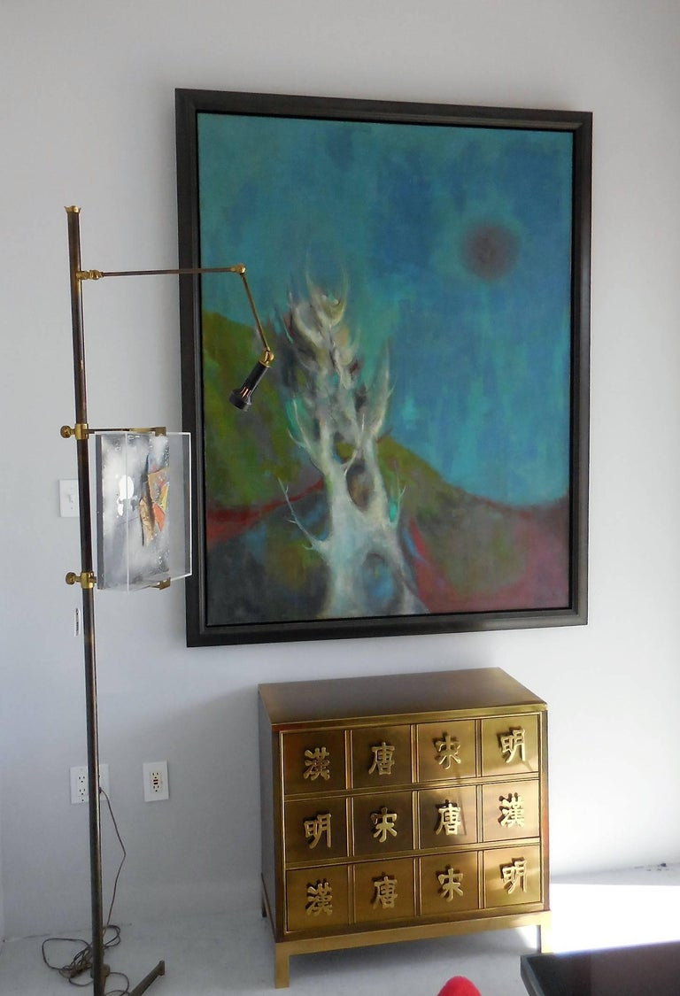 A large oil on canvass depicting an stylized, almost abstracted to the basic organic forms, landscape. Beautiful harmonic colors with an interesting poetic design. Signed illegibly and dated on lower right corner. Retains solid wood frame of the