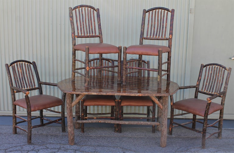 This amazing seven pieces matching chairs and oval table signed Old Hickory. All in very good condition. The tabletop is a marque inlaid top.  Measures: Armchairs 41 x 28 x 28 only on arm chair in stock.  Side chairs 41 x 19 x 19  Seat height for