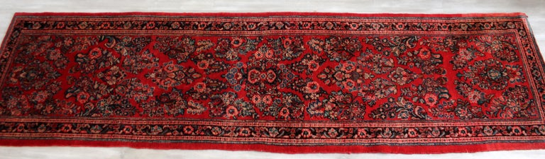 For your consideration is a beautiful and long, hand knotted wool runner rug, handmade. In very good vintage condition. The dimensions are 32.5