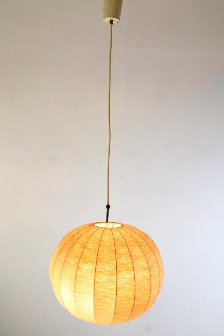An original 1960s Cocoon pendant by Achille and Pier Giacomo Castiglioni.
