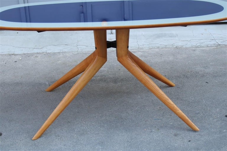 Midcentury oval dining table in chestnut and acrero cobalt blue glass Dassi Milano.
