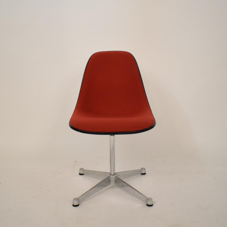 This midcentury padded red side /pedestal chair by Eames by Vitra for Herman Miller was made in the 1970s.