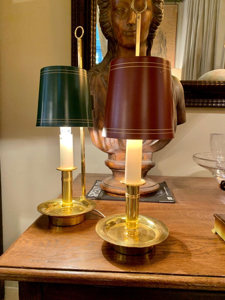 A pair of boullitte lamps, in gold brass and metal lampshade, can be used both to place them on a table and to hang them on the wall as a wall lamp.