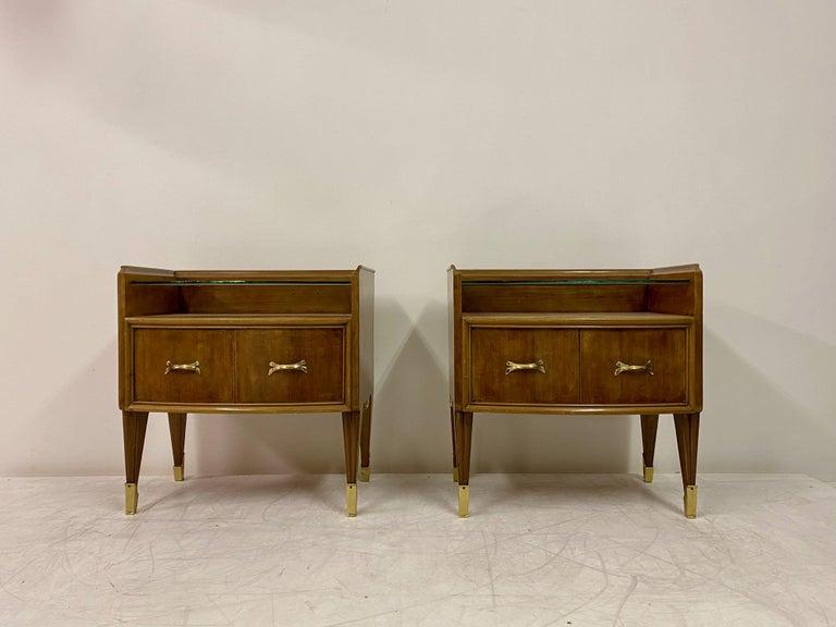 Pair of bedside tables  Brass feet  Brass handles  Glass shelf  1950s Italian.