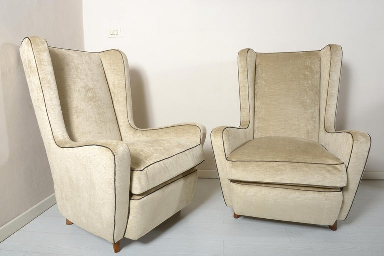 Pair of armchairs designed by the Architect Gamberini in the 1940s for a Florentine residence, solid walnut sculptured feet and newly upholstered with champagne color cotton velvet. This pair of really comfortable armchairs derive from the study
