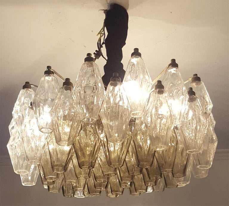 Two originalVenini chandeliers manufactured in Murano glass;  ModelPoliedri in two colors with the core part in grey colored Poliedri,  produced in Venice and designed by Carlo Scarpa.   The glass body has 51 cm of diameter and 30 height. Plus