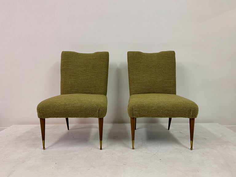 Pair of chairs  New upholstery in designs of the time wool linen blend fabric  Walnut frame  Brass ball feet,  1950s, Italian.