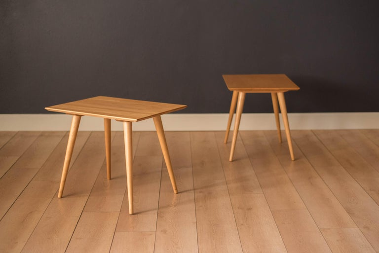 Mid Century pair of Planner Group side tables designed by Paul McCobb for Winchedon Furniture. This set features a rectangular solid planked maple top and Classic splayed dowel legs. Price is for the pair.    Offered by Mid Century Maddist