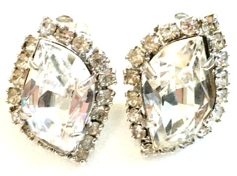 1960'S Pair Silver & Swarovski Crystal Rhinestone Earrings By, Weiss. Features silver rhodium plate and prong set brilliant Swarovski crystal clear large and rare irregular hexagon cut and faceted center stone, surround by round stones These