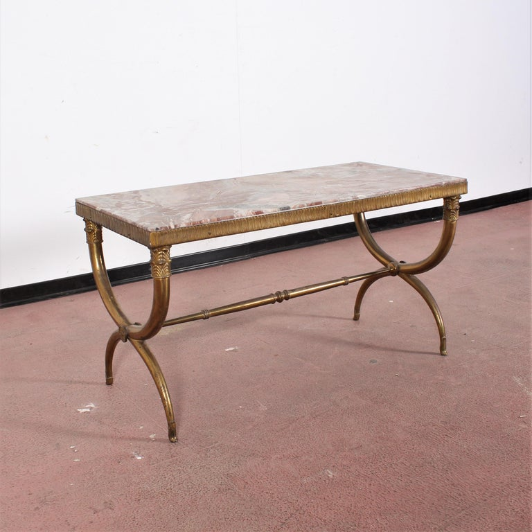Elegant coffee table made of curved solid brass with colored marble top. Attributed to Paolo Buffa, Italian production of the 1950s. Wear consistent with age and use.