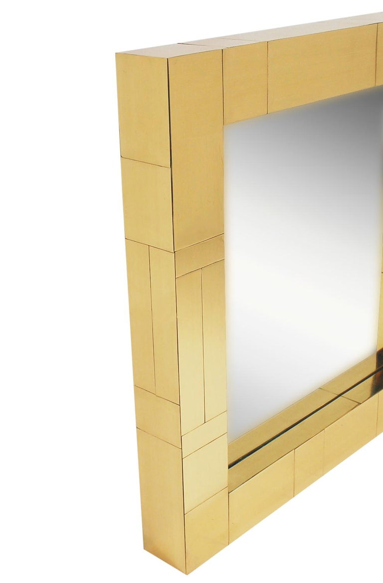 An incredible design combination, a cityscape wall shelf and mirror designed by Paul Evans in the 1970's. The set features fine heavy construction with brass clad patchwork design. Includes two L shaped wall brackets, wall mirror, and heavy clear