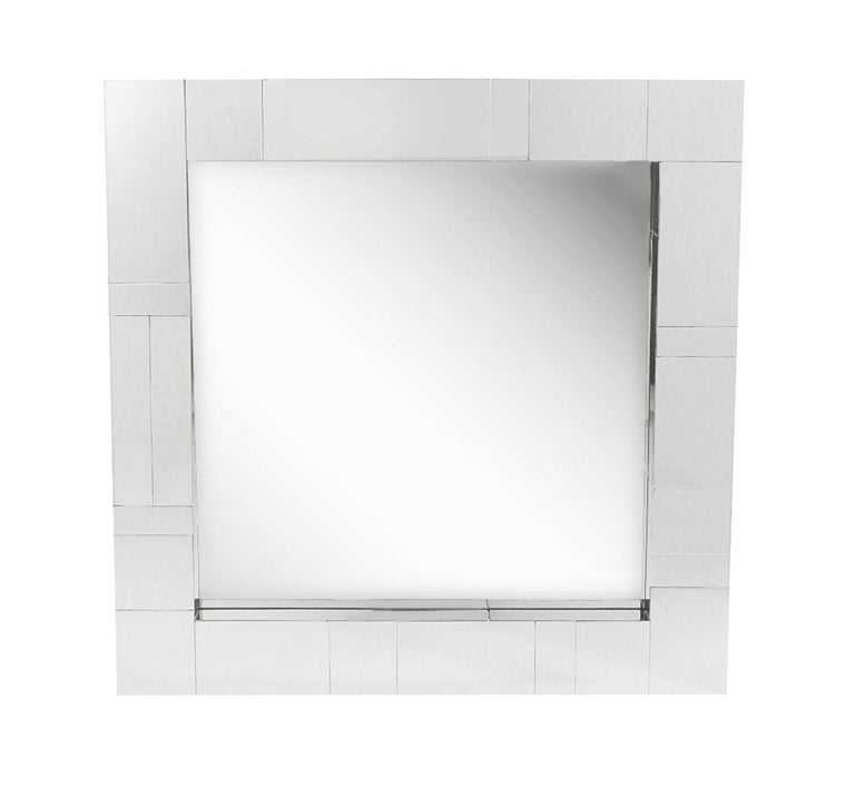 An incredible design combination, a cityscape wall shelf and mirror designed by Paul Evans in the 1970's. The set features fine heavy construction with chrome clad patchwork design. Includes two L shaped wall brackets, wall mirror, and heavy clear