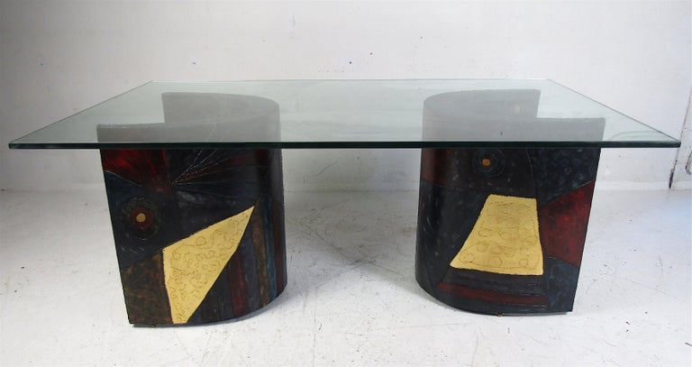 An interchangeable design by Paul Evans. Beautiful vintage modern glass top dining table with a two-piece crescent shaped enameled steel base. The 3/4 inch thick glass top and the colorful welded metal base makes this table Stand out in any setting.