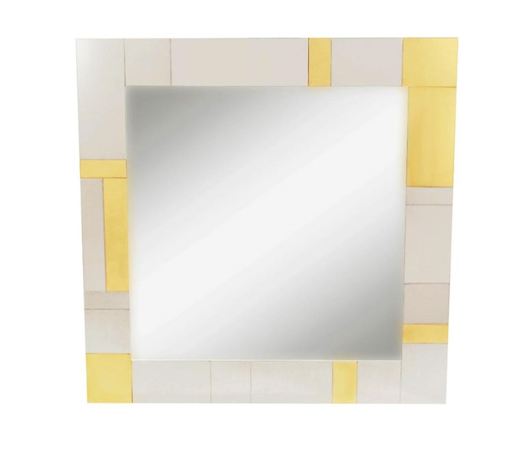 An incredible design combination, a cityscape wall shelf and mirror designed by Paul Evans in the 1970's. The set features fine heavy construction with brass & chrome clad patchwork design. Includes two L shaped wall brackets, wall mirror, and heavy