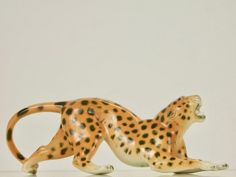 Lovely vintage midcentury German porcelain figurine depicting a growling wild cat/leppard.