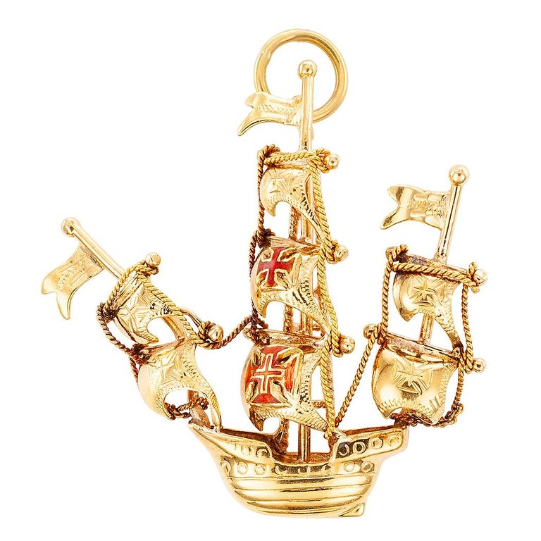 Mid-century Portuguese galleon enamel and gold charm pendant circa 1950. The handcrafted, 19-karat gold design features three masts at full sail, the latter decorated with elements typical of ships from the period being represented by the charm. Two