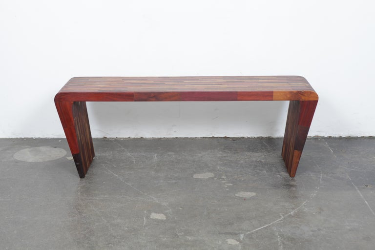 A one-of-a-kind sculptural solid Jatoba console table by artist Tunico T. Table has tapered, angled sides, made from naturally felled wood, Brazil, 2000s.