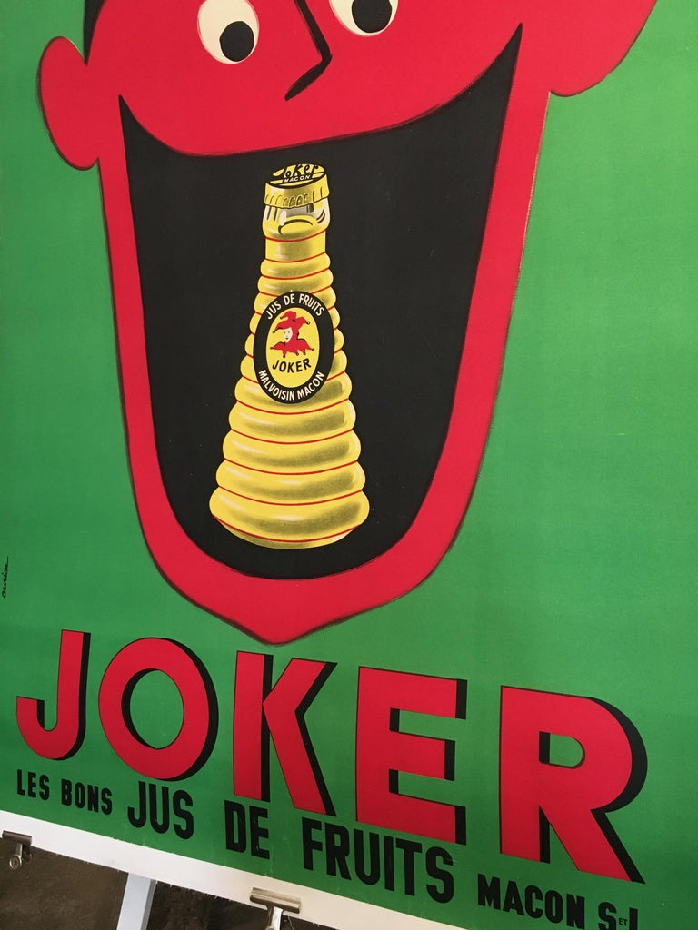 Midcentury rare French original vintage fruit-juice poster, 'Joker', 1957.  An original vintage poster advertising a fruit juice, this poster is rare as it was mainly printed with a blue background, the rare green background is now hard to come
