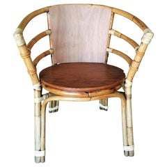 Mid-Century Rattan Barrel Back Armchair with Skeleton Arms